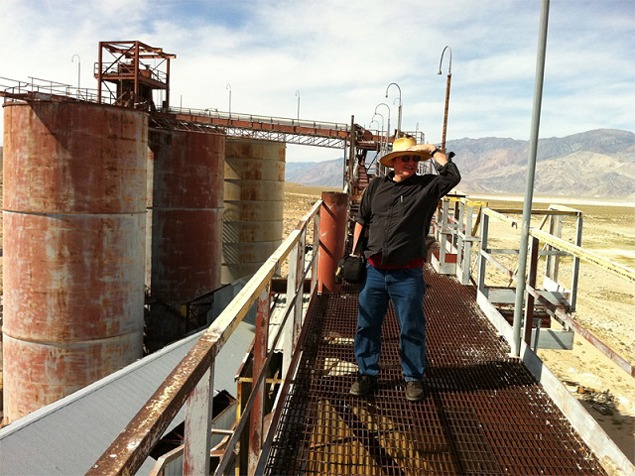 Matt Coolidge of the Center for Land Use Interpretation gazes out across Owens Dry Lake from atop the gantry at Pittsburgh Plate Glass. Photo by Bill Fox, 2012.