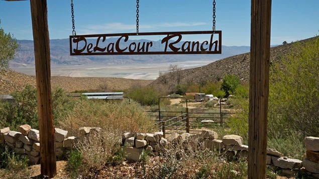The De La Cour Ranch with the Owens Lake and its dust mitigation ponds in the background. Photograph by Adam Levine, Courtesy of the Metabolic Studio, 2012.