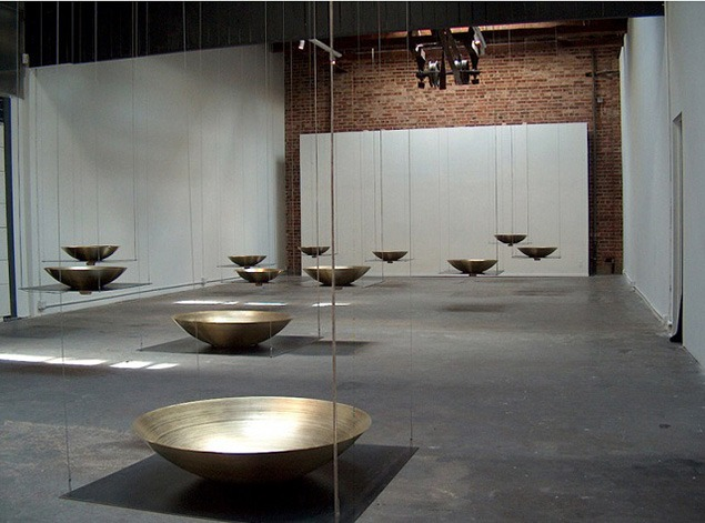 Steve Peters, Alchemy, 2005, Center on Contemporary Art, Seattle, WA. Spun brass bowls with transducers attached and through which recorded voices are played, creating pure tones that resonate into the space.