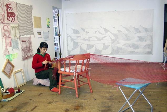 Nami Yamamoto in her Philadelphia studio lacing a fog catcher. Image courtesy of Nami Yamamoto.