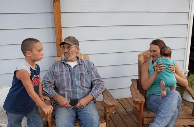 Scott Davis, son Damon, daughter Sara, granddaughter Ayla, August 2011. Photo by Terry Evans.