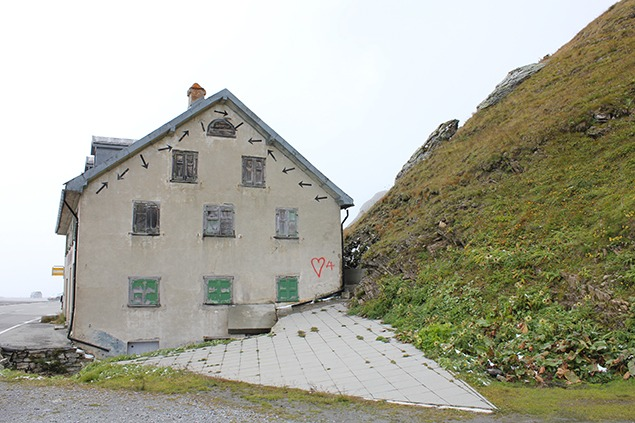 "Richard Long's ""Wind Line over the Furka Pass,"" 1989, the wall of the annex building atop the pass now also embellished with graffiti. Photo by Sara Frantz"