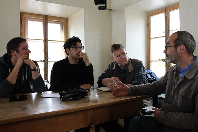 From left to right, Benîot Antille, Julian Myers-Szupinska, myself, and Janis Osolin talking in the Furka Hotel café. Photo by Sara Frantz.