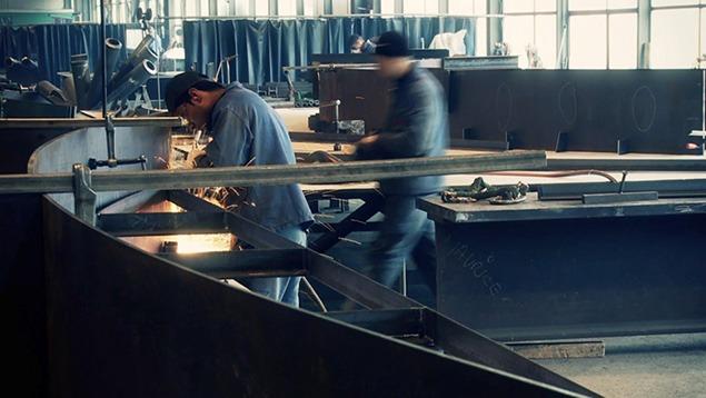 Core-ten steel arcs being prepared for the Heizer sculpture.