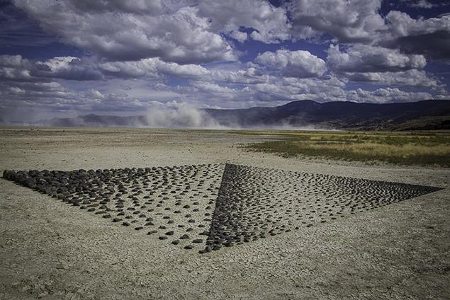 "Roger Asay & Rebecca Davis, ""Black Diamond,"" 2014. Basaltic stones on alkali lakebed. Photo courtesy of Bob Keefer."