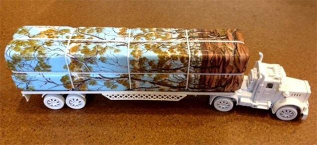 Dale Cox, Logging Truck V, 2013, plastic toy truck, acrylic on wood, cord.