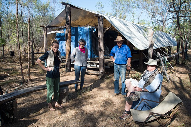 Georgia Valance, Mandy Martin, Guy Fitzhardinge and Bill Fox planning the day at Kubulwarnamyo. Note the tent structure in the background. Photo by David Leece.