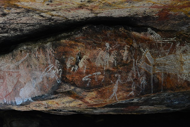 Layers of rock art representing millennia of evolving styles on the Arnhem Land plateau. Photo by David Leece.