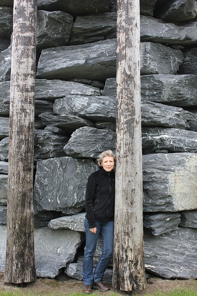 Sara standing with the trees and boulders of Bonanno's sculpture to provide a bit of scale. Now, go back to the previous photo of the sculpture and notice the giant green bicycle sculpture standing atop the bridge in the background over her right shoulder. Anyone care to explain that?—yet another unsigned mystery in the Norwegian landscape. Photo by Bill Fox.