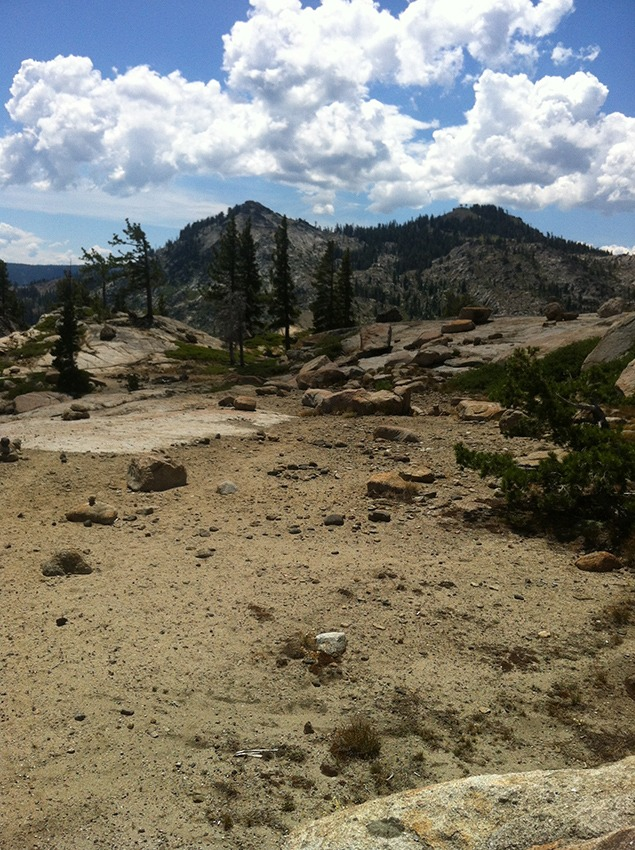 Remnants of Donner Pass Circle, 2015. Photo by Bill Fox. The original circle is faintly outlined in the foreground with a lighter colored patch of bare granite behind it. The more recent, smaller circle is clearly defined and sitting almost at what was the center of Long's circle.